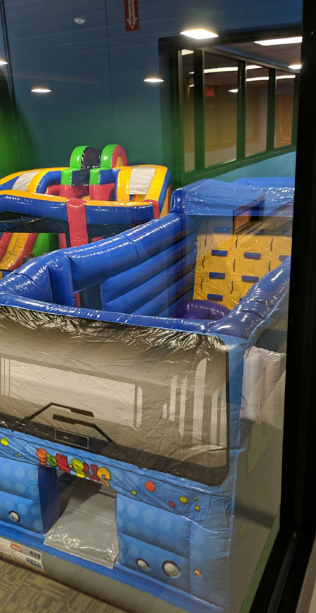 fun bus bounce house obstacle course